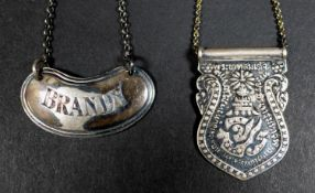 A George V silver decanter label, of kidney form with line border, engraved 'Brandy', Atkin