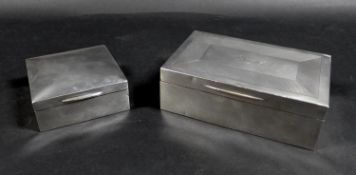 Two George V silver cigarette boxes, comprising a rectangular form box with 'Angus' inscribed to its