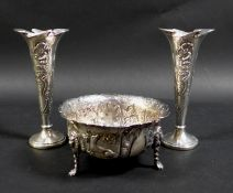A pair of Edward VII Art Nouveau silver spill vases, with whiplash shaped rims and relief floral