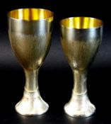 A pair of Christopher Nigel Lawrence limited edition modernist silver goblets, of waisted form
