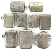 A group of Edwardian silver vesta cases, including a round example with engraved swirling