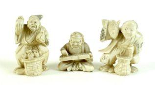 A group of three Japanese ivory katabori netsuke, Meiji period, comprising a pair of vendors, one