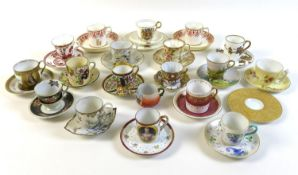 A group of seventeen coffee cups and saucers, together with an Elizabeth II commemorative trio, a