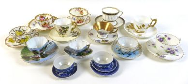 A group of thirteen teacups and saucers, together with an extra blue and white saucer. (14)