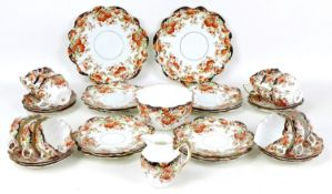 A 19th century porcelain part tea service, decorated with Indianische Blumen in ironstone red,