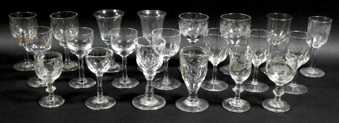 A collection of clear glass drinking glasses, mostly Victorian and later liqueur glasses,