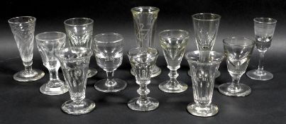 A small collection of clear glass drinking glasses, mostly Victorian and later, including dwarf