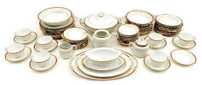 A Japanese Satsuma china part dinner and tea service, decorated with iron red bands to the rims