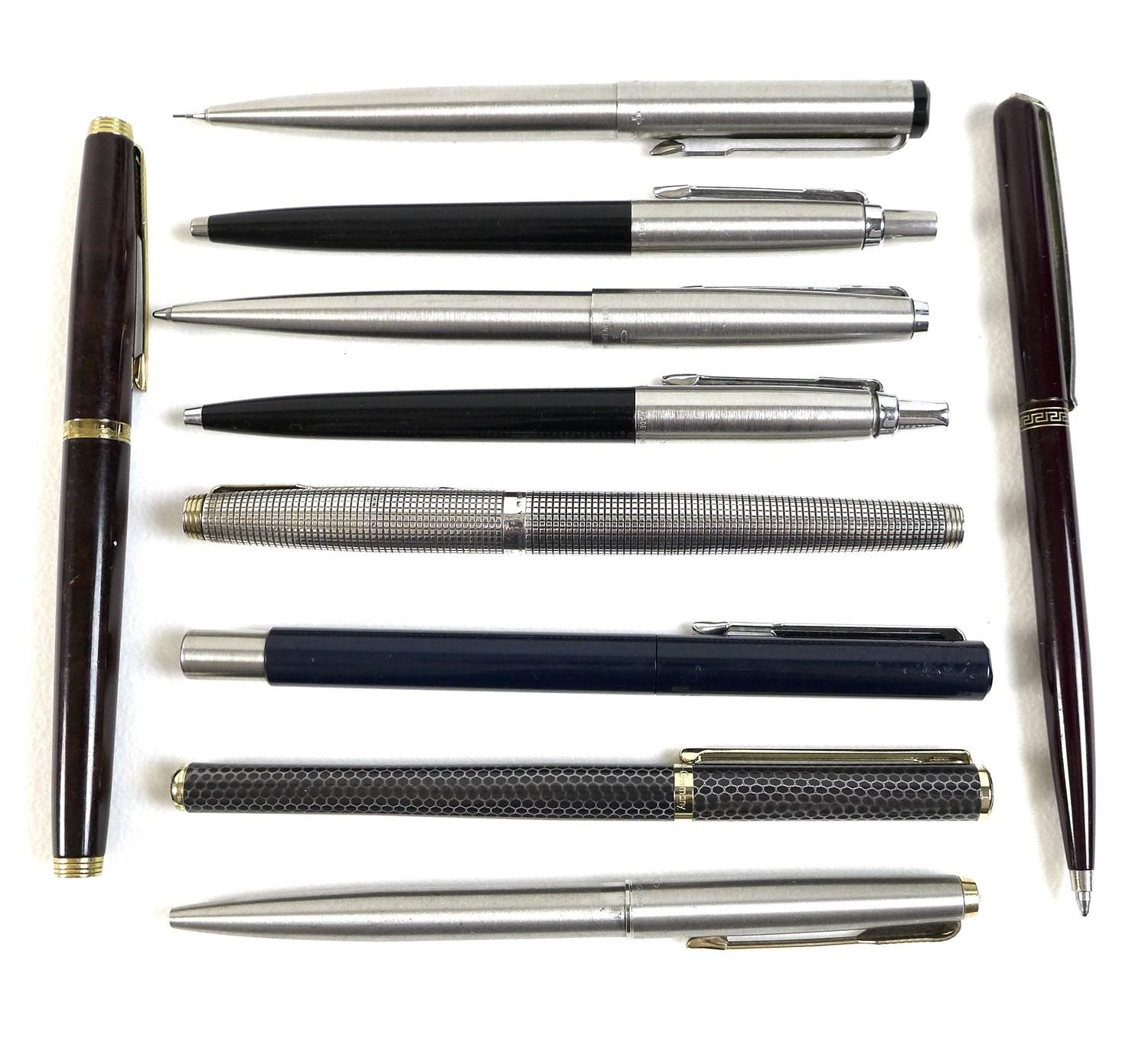 A collection of writing instruments, mostly Parker pens, comprising a Stirling Silver Parker pen,