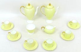 A 1930s Wedgwood coffee set in lemon yellow, pattern no. 'W4098', comprising two coffee pots, both
