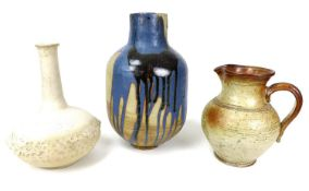 A group of studio pottery ceramics comprising a large vase of wide baluster form, slip glazed with