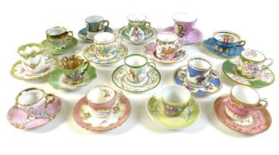 A group of sixteen coffee cups and saucers, in pastel shades.