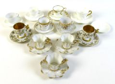 A group of eleven coffee cups and saucers, together with a single white saucer. (12)