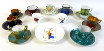 A group of Russian Imperial ceramics, comprising two coffee cups and a plate, together with a