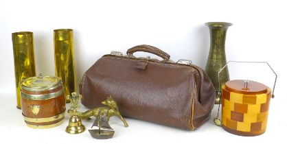 A group of collectables, including a pair of shell case vases, a vintage Gladstone bag, and two