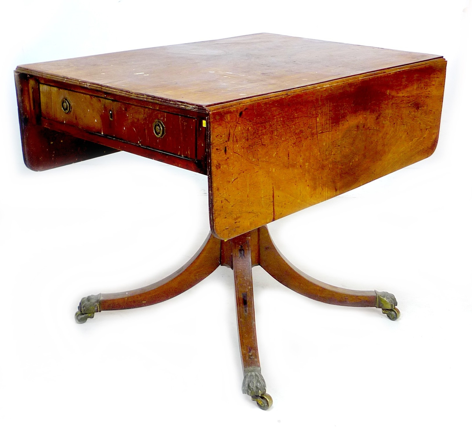 A Regency mahogany sofa table, with single frieze drawer, raised on four outswept legs with brass