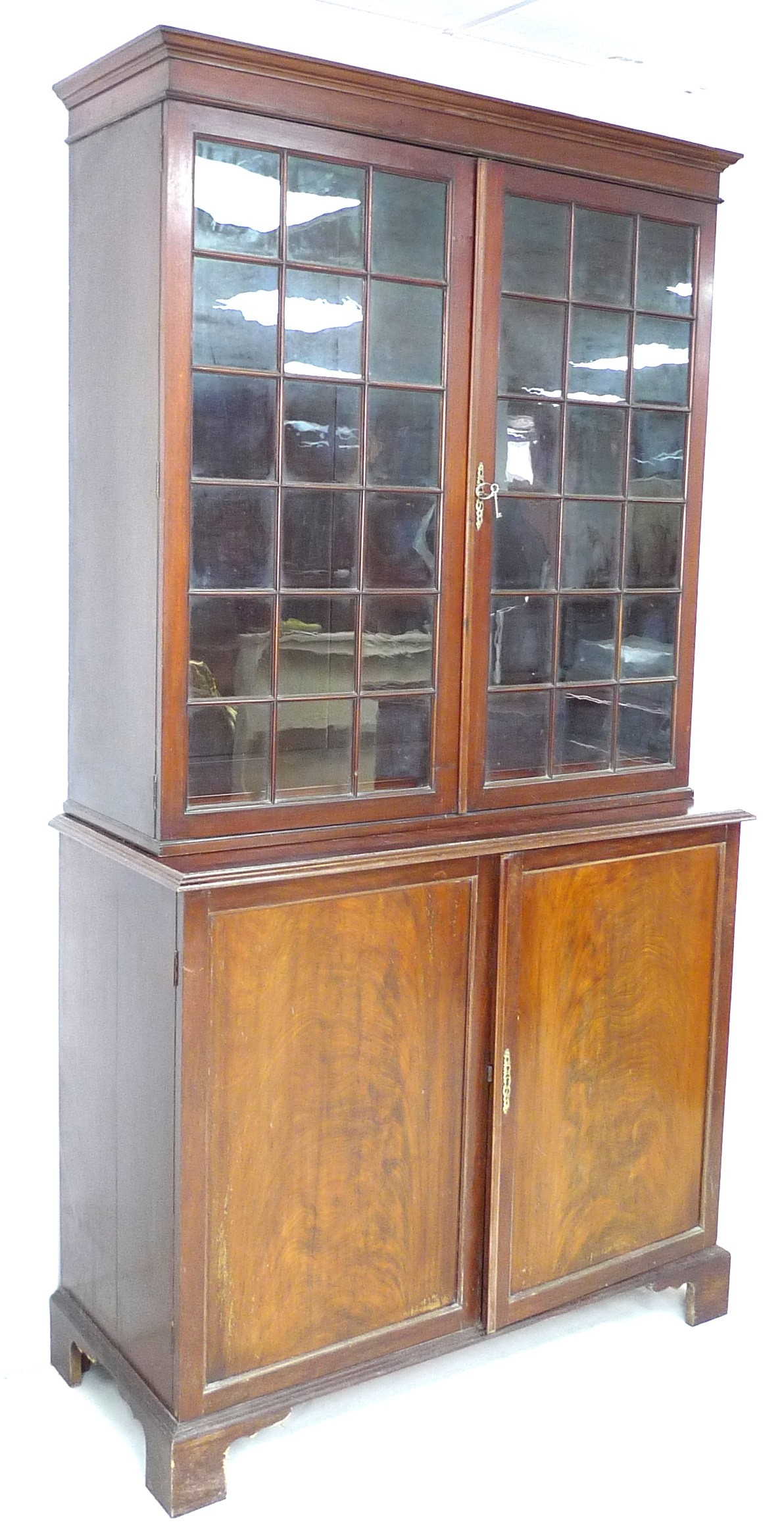An Edwardian mahogany bookcase, with astragal glazed double doors, above a cupboard base, raised - Image 3 of 3