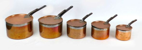 A group of five 19th century copper saucepans and matching covers, of graduating size, largest 45.