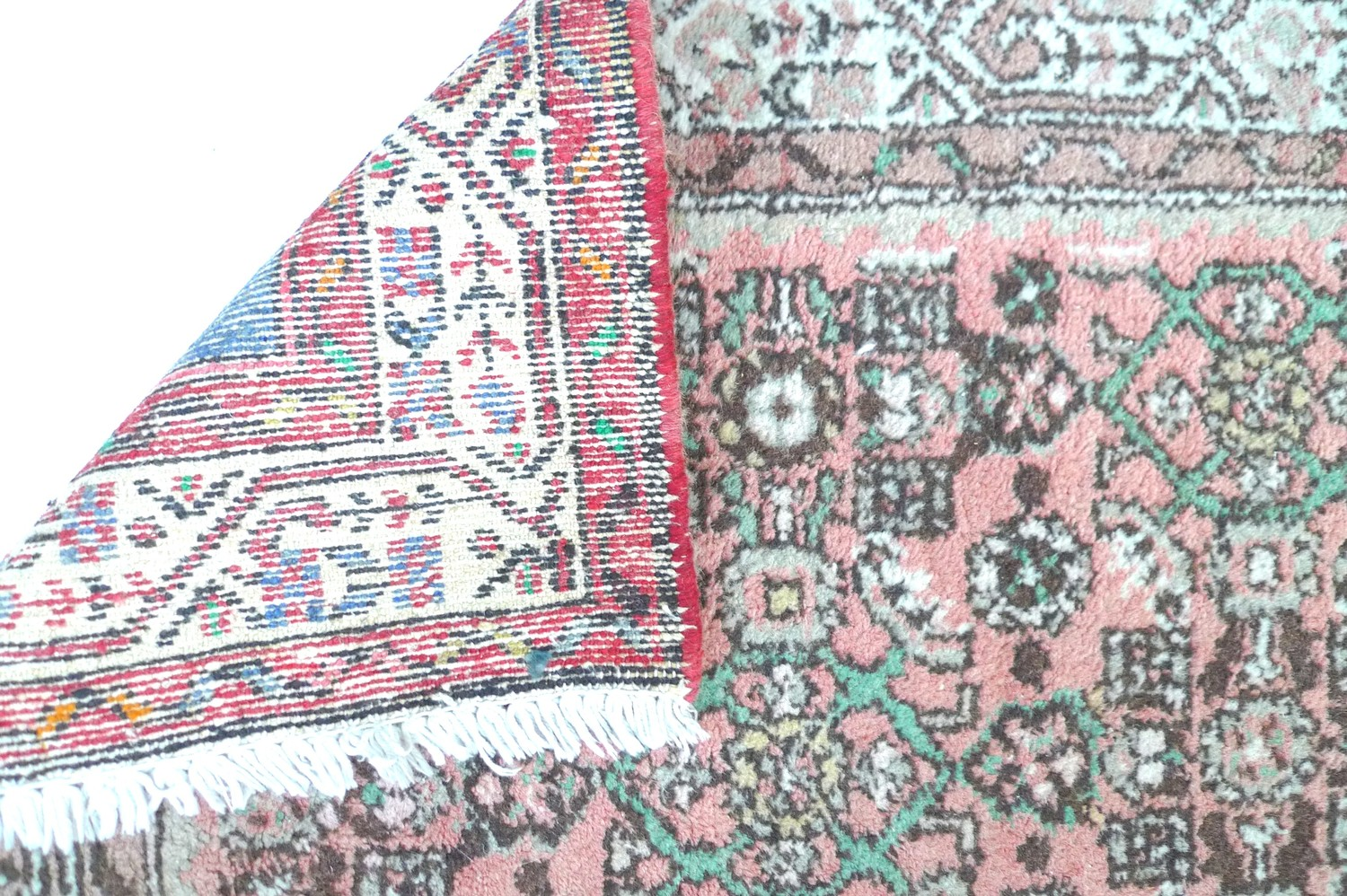 A small Persian prayer rug, with pale red ground, 120 by 85cm. - Image 2 of 2