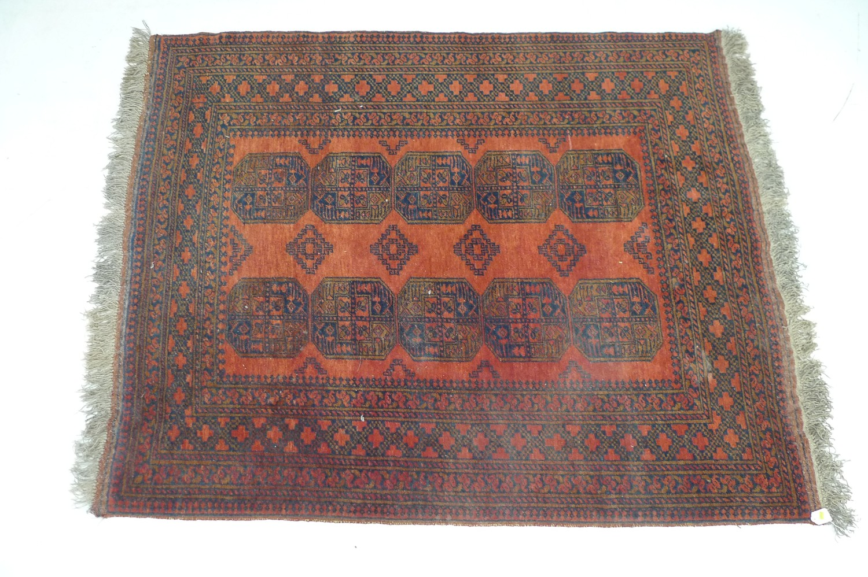 A Tekke rug, black and orange, 150 by 200cm.