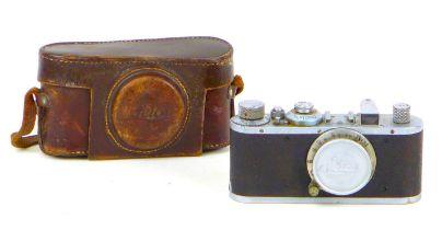 A vintage 1930s Leica camera, with Leitz Elmar 1:3.5 f=50mm lens, serial no. 168496, with chrome and
