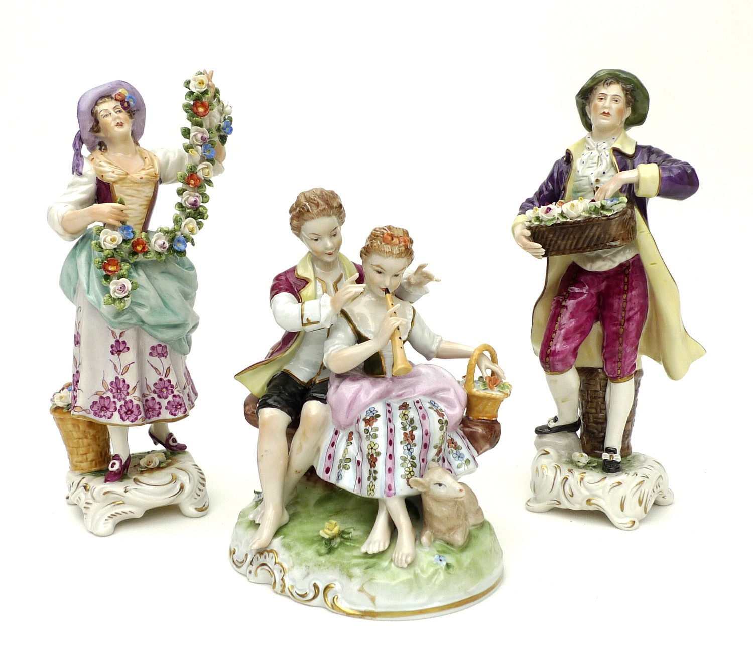A pair of Rudolstadt Volkstedt figurines, in the Dresden style, comprising male and female flower