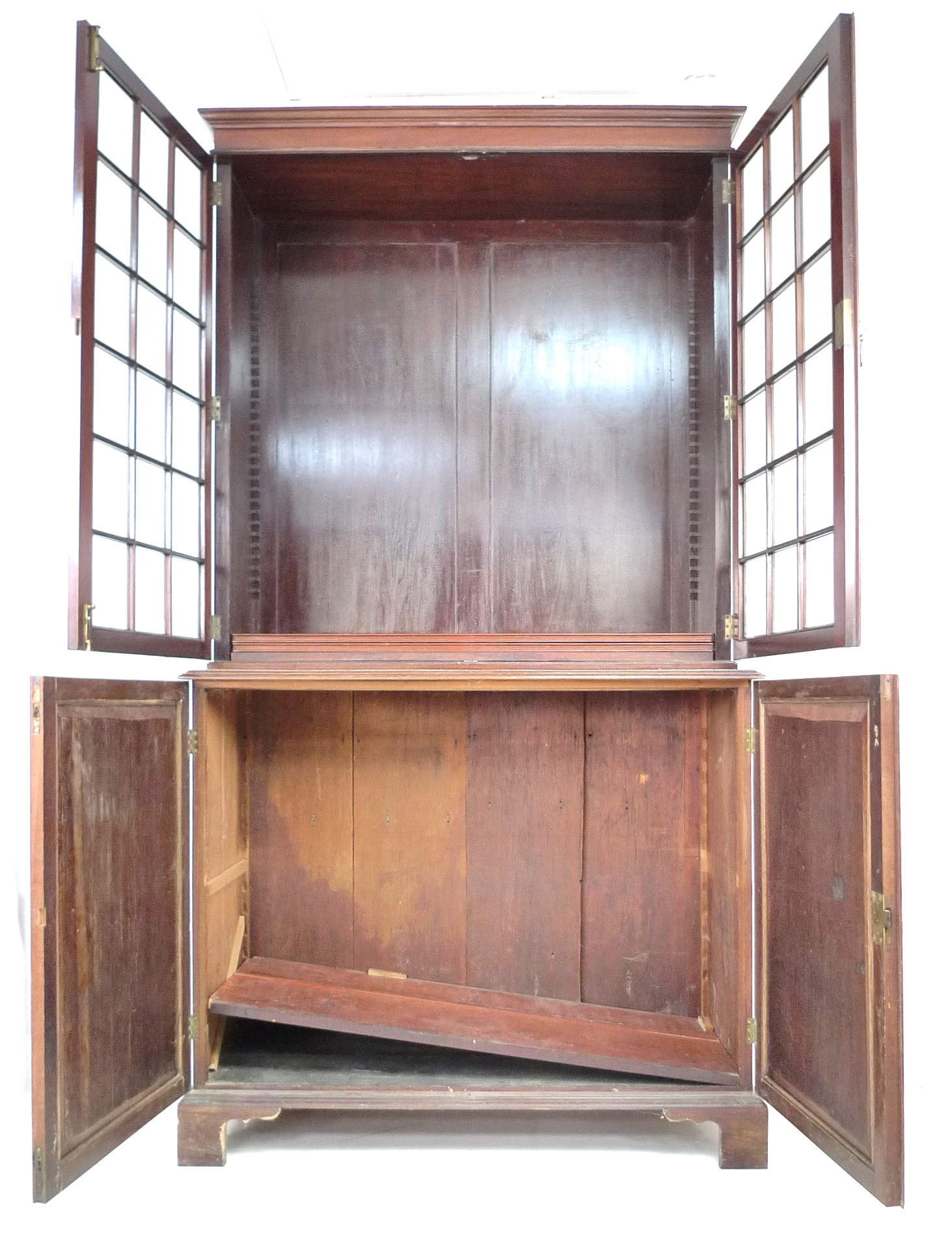 An Edwardian mahogany bookcase, with astragal glazed double doors, above a cupboard base, raised - Image 2 of 3