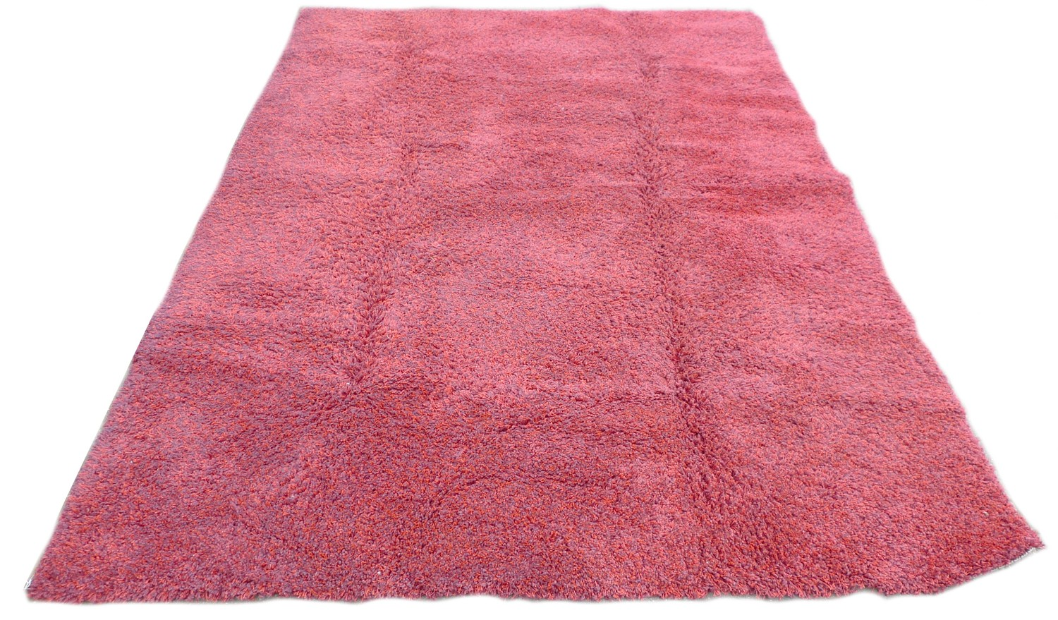 A large contemporary 'Opus Shaggy' rug, with crimson ground, 245 by 345cm.