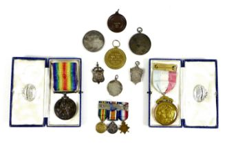 A group of military and sporting medals, comprising Victory and War medal, awarded to Private T