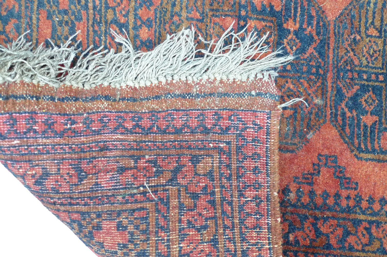 A Tekke rug, black and orange, 150 by 200cm. - Image 2 of 2