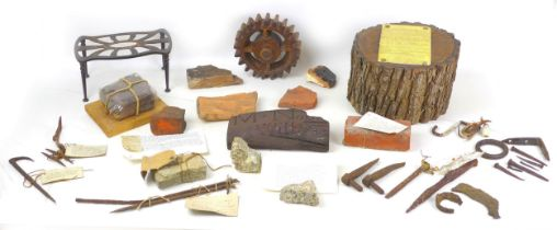 A collection of assorted archaeological and social history relics, including a piece of brick