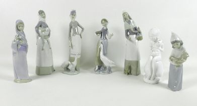 A group of six Lladro figurines, comprising Girl with Lamb, number 4584, designed by Antonio Ruiz,