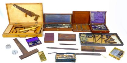 A group of vintage engineering related items, including technical drawing instruments, tools, a 1938