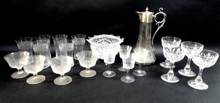 A silver plated and etched glass claret jug, of flared fluted form, decorated with ferns and