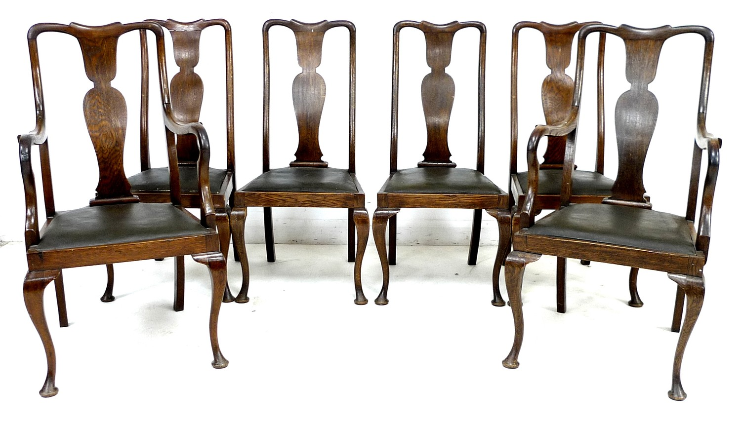 A set of six early 20th century oak dining chairs, 52 by 55 by 106cm high, in Queen Anne style