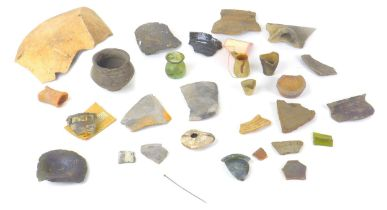 A collection of archaeological items, including a Roman white metal pin, found in Rodbridge, Long