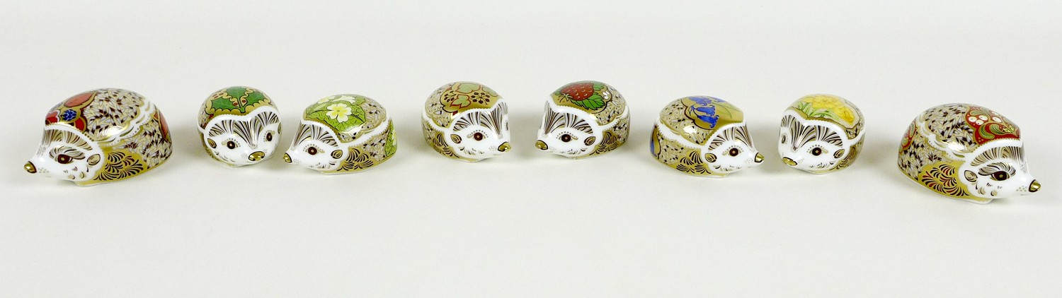 A group of eight small Royal Crown Derby paperweights, all modelled as hedgehogs, comprising '