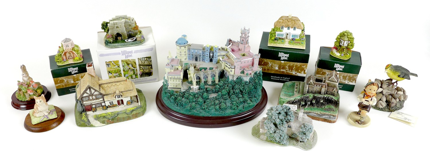 A collection of decorative ornaments, comprising six Lilliput Lane dwellings, Windsor Cottage,