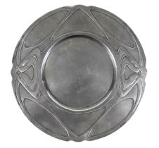 An Art Nouveau pewter plate in the style of Liberty's Tudric, sticker to underside reads 'Hornsby