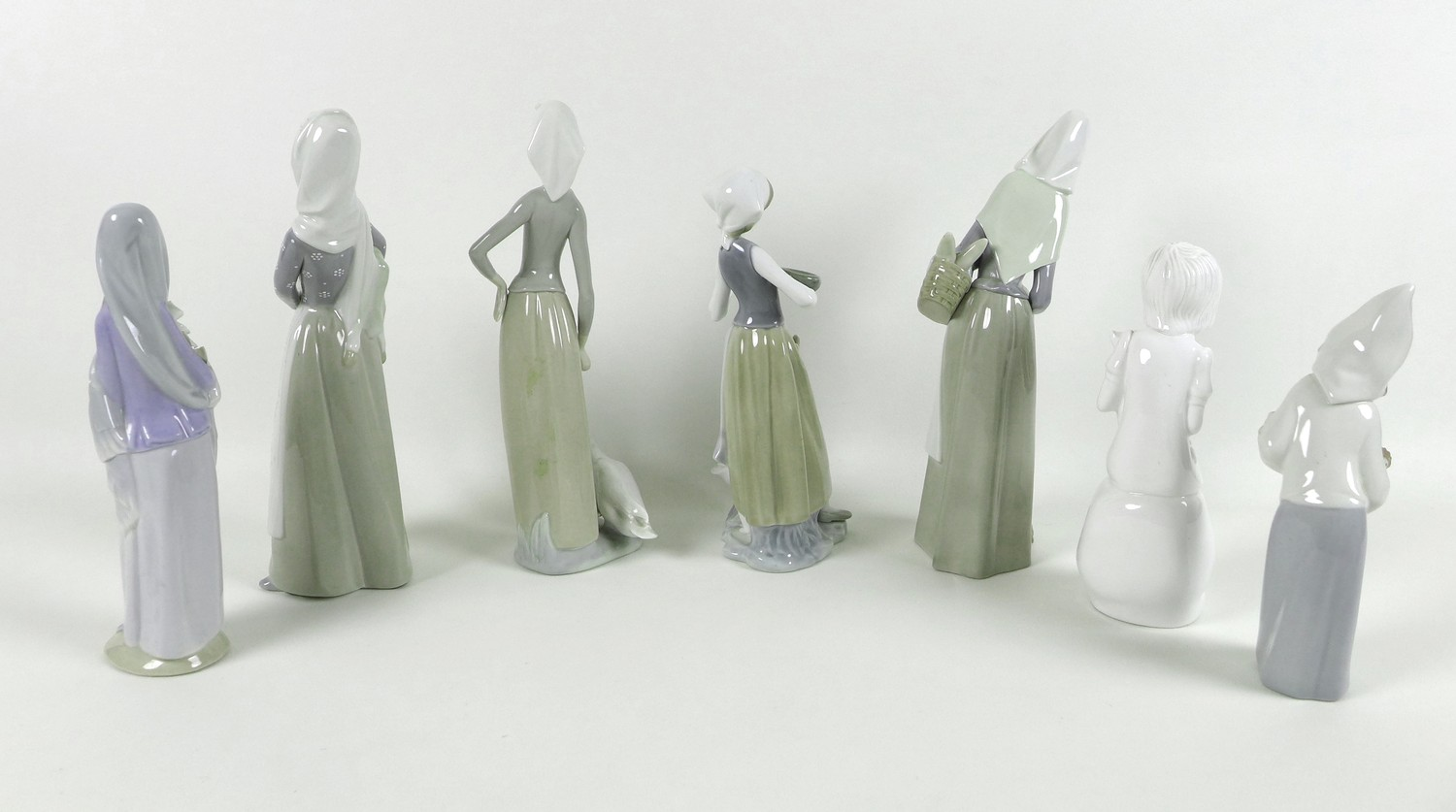 A group of six Lladro figurines, comprising Girl with Lamb, number 4584, designed by Antonio Ruiz, - Image 2 of 3