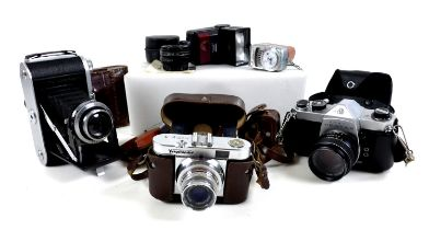 A collection of vintage cameras and accessories, including a Voigtlander Vito B, with case, an