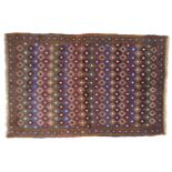 A Baluchi rug with umber ground, diamond patterned field, in red, blue, royal blue, cream and green,