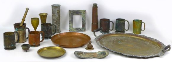 A collection of assorted metal wares, including a Chinese bronzed medal photograph frame mount, with