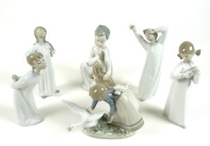A group of six Lladro figures, comprising Wild Goose Chase, number 5553, 15cm high, Nino con