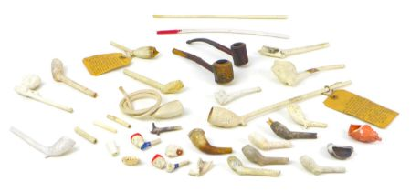 A collection of seventeen circa 17th century and later clay pipes, including a Gouda pipe
