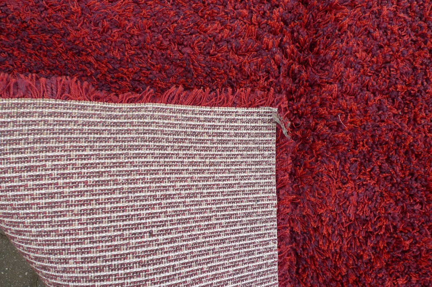A large contemporary 'Opus Shaggy' rug, with crimson ground, 245 by 345cm. - Image 2 of 3