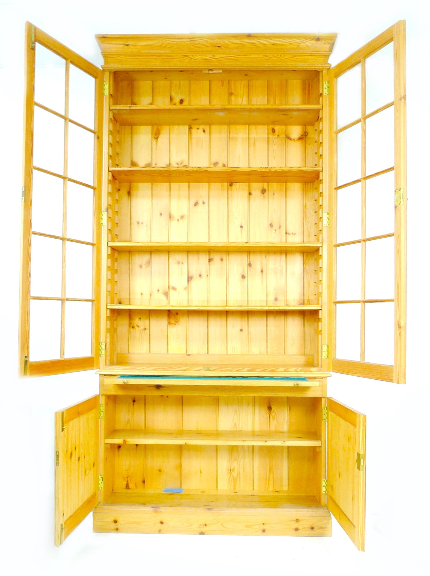 A modern pine bookcase, twin glazed doors, each with ten panes, enclosing four shelves, slide with - Image 2 of 3