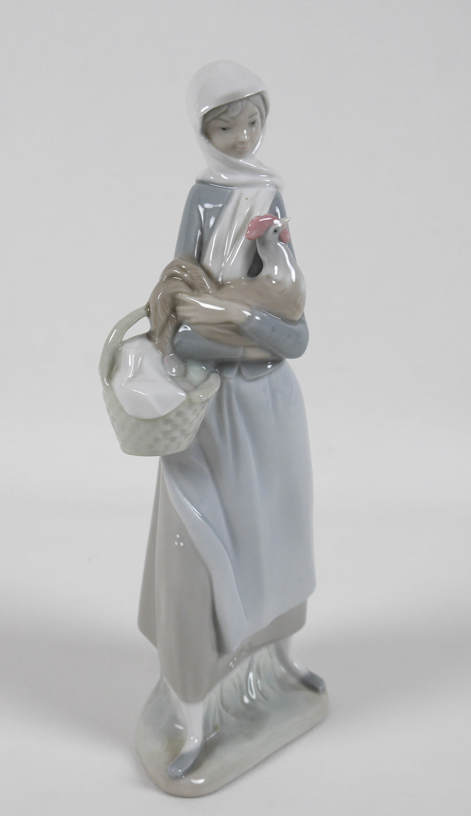 A group of five Lladro figures, comprising Armful of Lilies, number 4972, 24cm high, Peasant Girl - Image 10 of 11