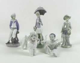 A group of five Lladro porcelain figures, including Fisherboy, number 4809, 21.5cm high, Boy with