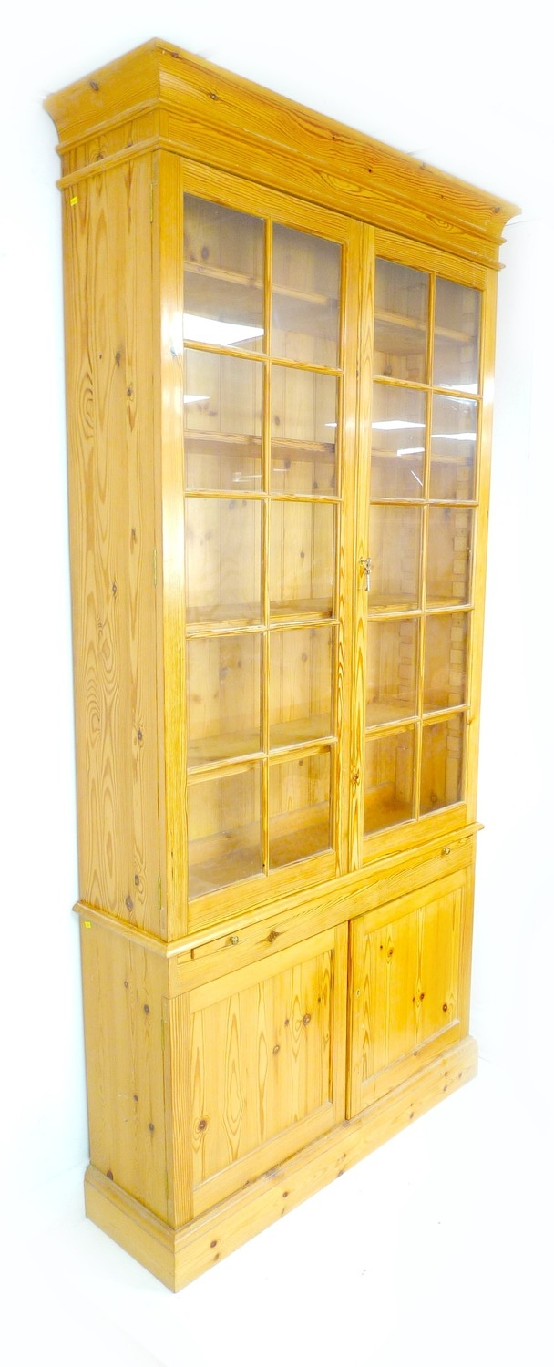 A modern pine bookcase, twin glazed doors, each with ten panes, enclosing four shelves, slide with - Image 3 of 3
